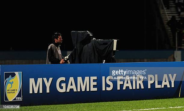 Television Cameramen work during the FIFA U17 Women's World Cup Group B match between Mexico and South Africa at the Ato Boldon Stadium on September...