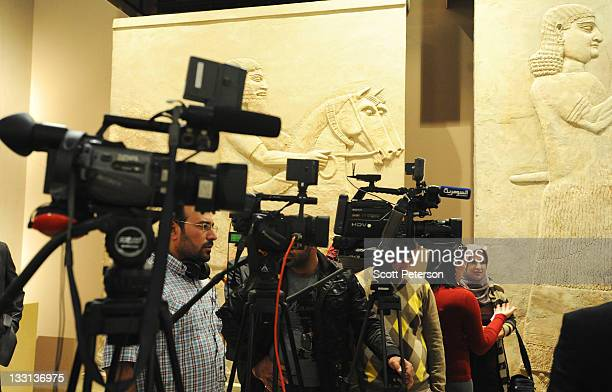 Television cameras are made ready for comments as Iraqi tourism and antiquities officials and French Embassy sponsors open an exhibit about the...