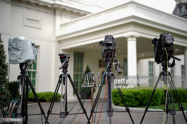 Television cameras are set up outside the West Wing at the White House April 18 2019 in Washington DC Later today the Department of Justice will...