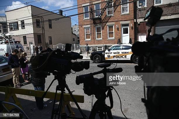 Television cameras sit outside the apartment of Alina Tsarnaeva sister of accused Boston Marathon bombers Tamerlan and Dzhokhar Tsarnaev on April 22...