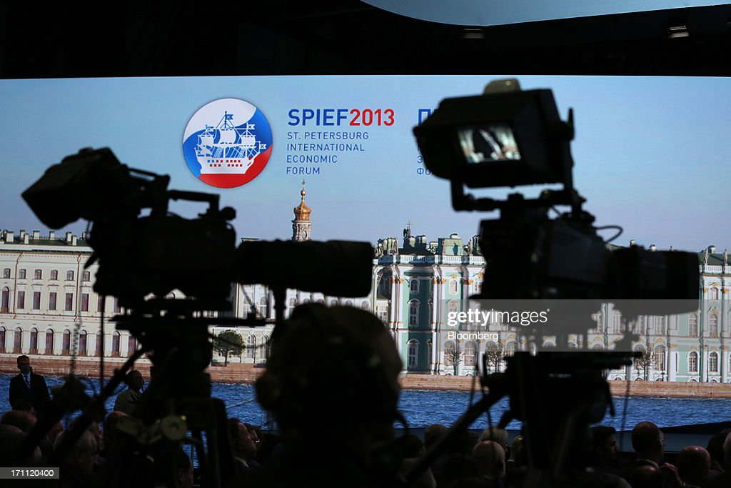 Television cameras stand prepared to film a joint speech session with Angela Merkel, Germany's chancellor, and Vladimir Putin, Russia's president, on day two of the St. Petersburg International Economic Forum 2013 (SPIEF) in St. Petersburg, Russia, on Friday, June 21, 2013. President Vladimir Putin is battling investor skepticism to woo foreign executives descending on his hometown today as Russia's economy faces a risk of recession and a crackdown on critics scares off intellectuals. Photographer: Andrey Rudakov/Bloomberg via Getty Images