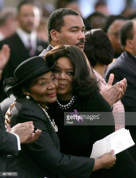 Television celebrity Oprah Winfrey embraces Christine King Farris sister of Dr Martin Luther King Jr as they attend a musical tribute for Coretta...