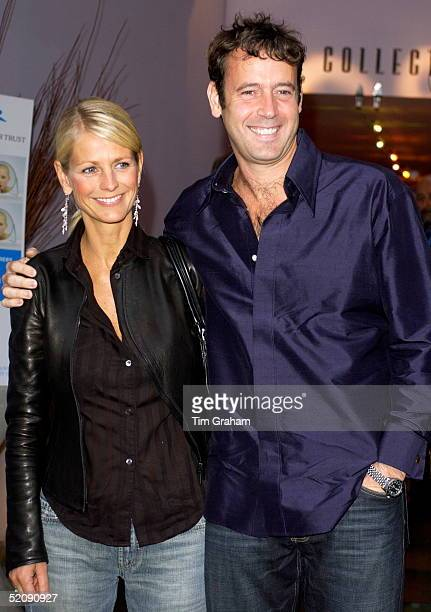Television Celebrity Ulrika Jonsson Being Cuddled By Her Husband Lance Gerrardwright Attending An Auction Of Designer Bandanna At The Collection...