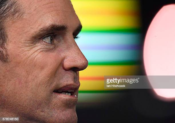 Television commentator and former NRL player Brad Fittler looks on before during the round 20 NRL match between the North Queensland Cowboys and the...