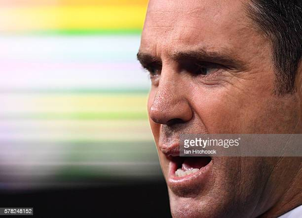 Television commentator and former NRL player Brad Fittler speaks before during the round 20 NRL match between the North Queensland Cowboys and the...