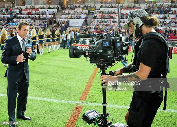 Television commentator Brett Kimmorley does a piece to camera before the round two NRL match between the North Queensland Cowboys and the Melbourne...