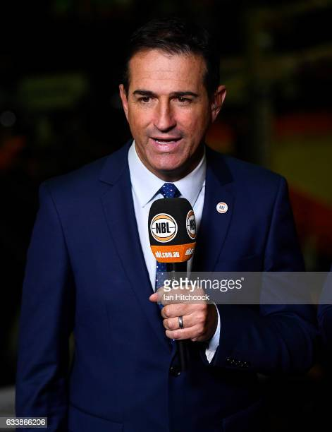 Television commentator Matt Russell does a piece to camera before the start of the round 18 NBL match between the Cairns Taipans and the Perth...