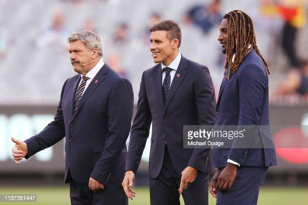Television commentators Brian Taylor and Matthew Richardson are seen with Nick Naitanui of the Eagles is seen during the round one AFL match between...