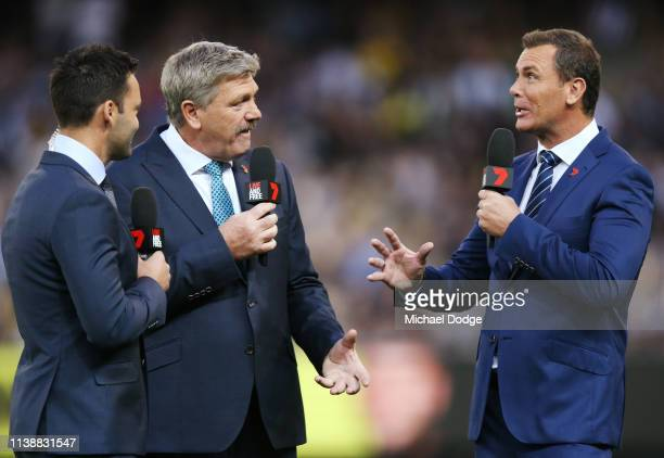 Television commentators James Bartel Brian Taylor and Wayne Carey are seen during the AFL Round match between Richmond v Collingwood at Melbourne...