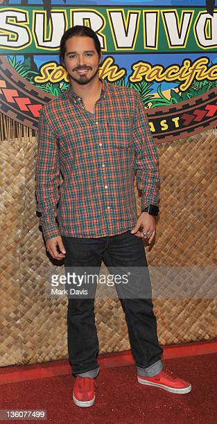 Television contestant Ozzy Lusth poses at the CBS' Survivor South Pacific Finale Reunion at CBS Television City on December 18 2011 in Los Angeles...