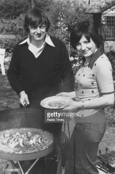 Television cook Delia Smith and her husband, writer Michael Wynn-Jones, using a barbeque in the garden of their home, for the BBC television series...
