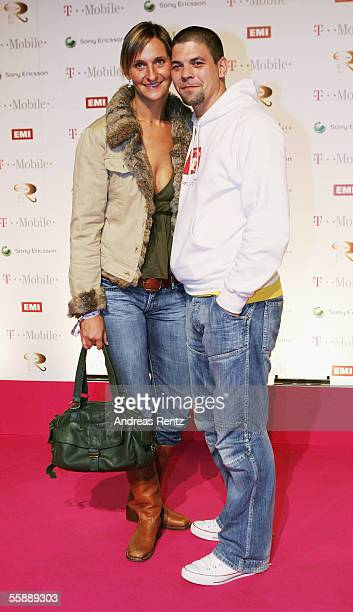 Television cooker Tim Melzer and girlfriend Nina Heik attend at the Robbie Williams Aftershow at the Kaisersaal on October 9 2005 in Berlin Germany...