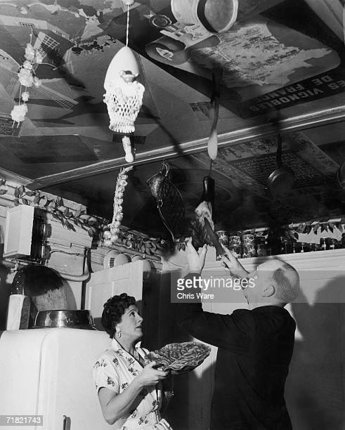 Television cookery expert Fanny Cradock and her husband John prepare a meal in their South Kensington home 5th April 1956 John cuts a slice of smoked...