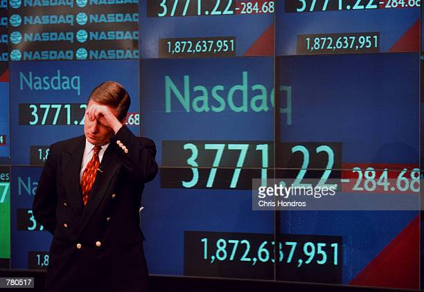 CNBC television correspondent Tom Costello wipes his brow before going on the air at the Nasdaq MarketSite in New York City just after the close of...
