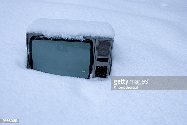 A television covered with snow
