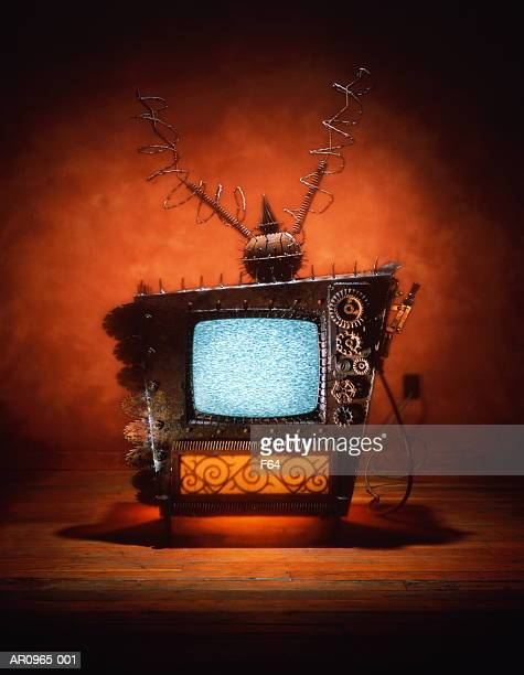 Television covered with spikes and barbed wire (Digital Composite)