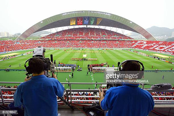 Television crew men film the teams presentation prior to the start of the quarterfinal match between South Korea and Spain at the 2002 FIFA World Cup...