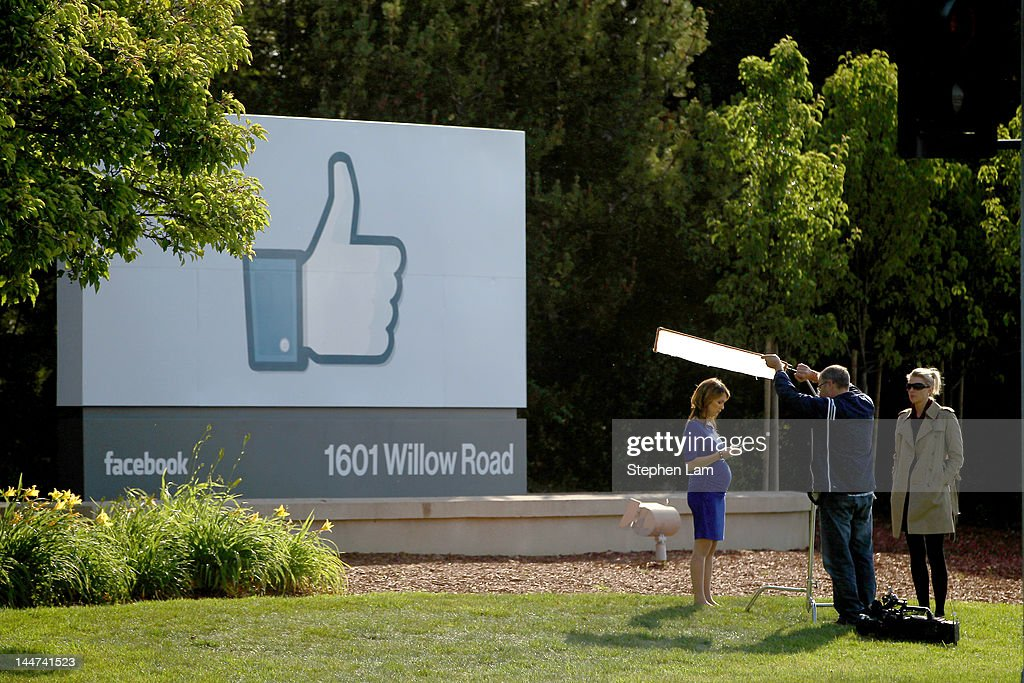 A television crew prepares for a broadcast in front of a 'like' sign outside Facebook headquarters May 18, 2012 in Menlo Park, California. The eight-year-old social network company listed their initial public offering on NASDAQ Friday morning at $38 a share and a valuation of $104 billion, making its IPO the third largest in U.S. history after General Motors and Visa.