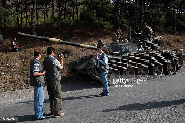 A television crew tapes in front of a a Russian tank August 14 2008 just outside of Gori Georgia Tensions continued in the north Georgian city as...