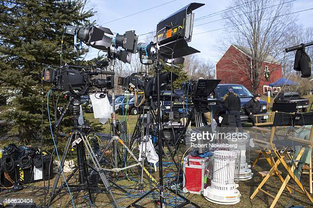 NBC television crew uses the front lawn of a private residence December 15 2012 near the Sandy Hook Elementary School to broadcast their daily news...