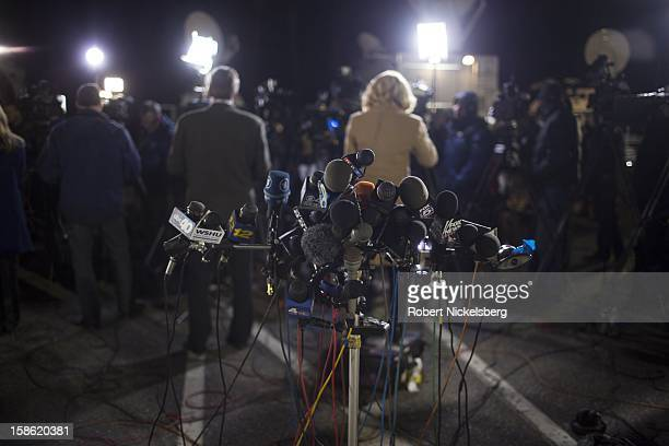 Television crews broadcast news following a press conference December 14 2012 in Treadwell Park Sandy Hook Connecticut about the Sandy Hook...