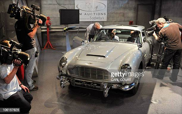 Television crews film a 1964 Aston Martin DB5 vehicle used by British actor Sean Connery when he played fictional spy James Bond in the films...