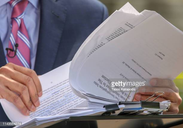 Television crews go over the Mueller Report outside the US Department of Justice on April 18 2019 in Washington DC Today the Department of Justice...