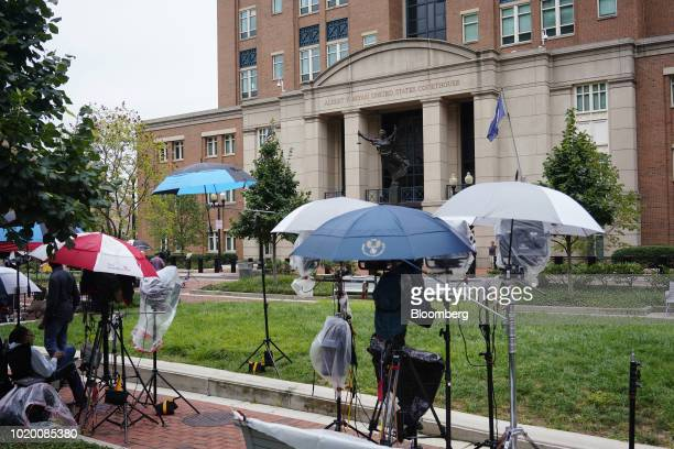 Television crews set up ahead of a third day of jury deliberations in the trial of former Donald Trump Campaign Manager Paul Manafort outside...