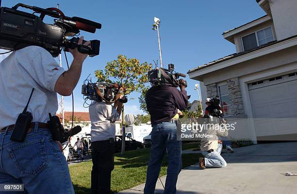 Television crews tape the closing of David Westerfields garage door, the only suspect in the case of missing seven-year-old Danielle van Dam, as he...
