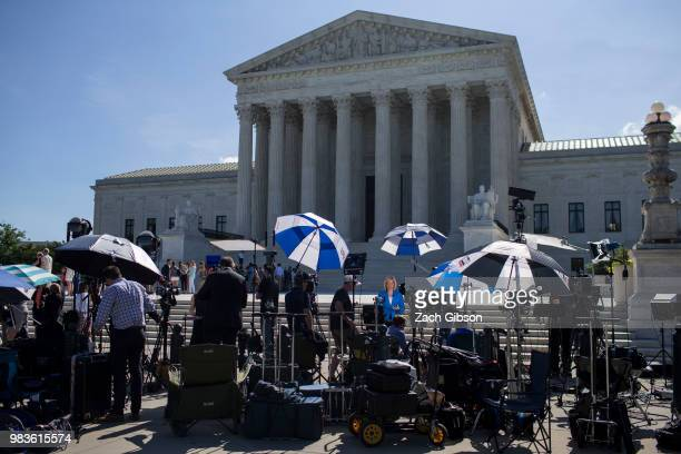 Television crews work in front of the US Supreme Court on June 25 2018 in Washington DC The high court is expected to issue decisions in six...