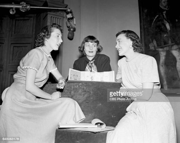 Television director Frances Buss assistant to Dorothy Doan Anne Kelleher and hostess of 'Vanity Fair' Dorothy Doan talk on the set of 'Vanity Fair'...