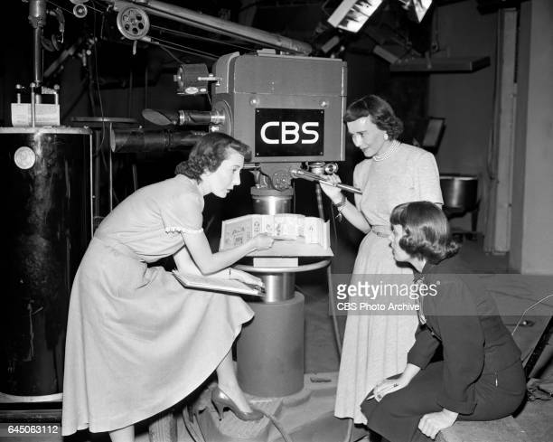 Television director Frances Buss hostess of 'Vanity Fair' Dorothy Doan and assistant to Doan Anne Kelleher talk on the set of 'Vanity Fair' the...
