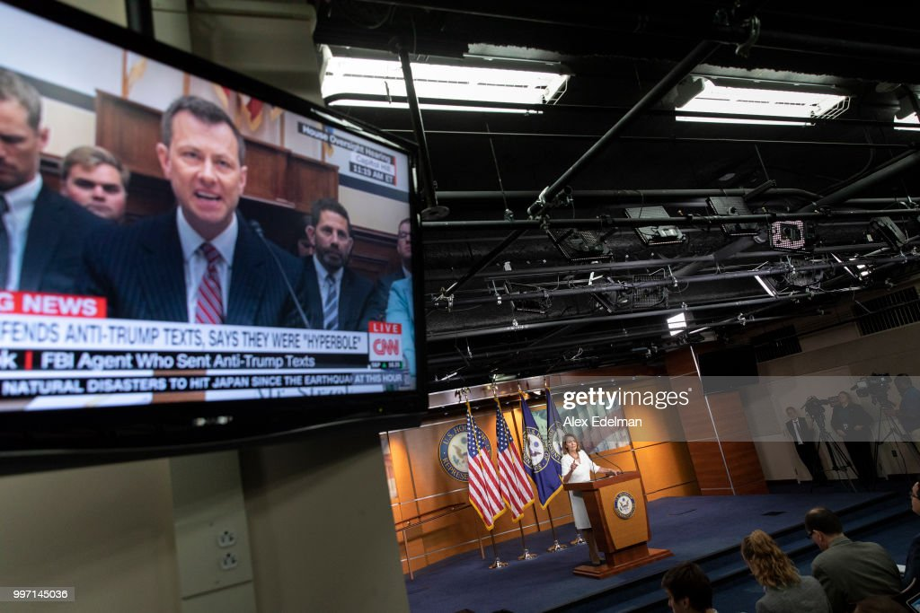 A television displays a House Oversight Committee hearing with FBI Agent Peter Strzok as House Minority Leader Nancy Pelosi (D-CA) speaks with reporters during her weekly press conference at the Capitol on July 12, 2018 in Washington, DC. While involved in the probe into Hillary Clinton's use of a private email server in 2016, Strzok exchanged text messages with FBI attorney Lisa Page that were critical of Trump.