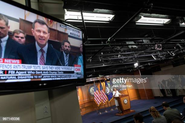 A television displays a House Oversight Committee hearing with FBI Agent Peter Strzok as House Minority Leader Nancy Pelosi speaks with reporters...