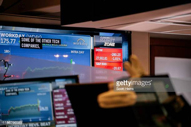 Television displays falling share prices on the floor of the New York Stock Exchange on December 3, 2019 in New York City. The Dow Jones Industrial...