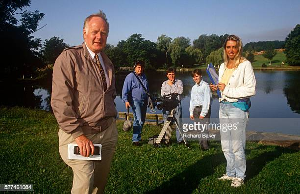 Television documentary film maker Desmond Wilcox and production crew during the filming of a programme The portrait is with members of his colleagues...