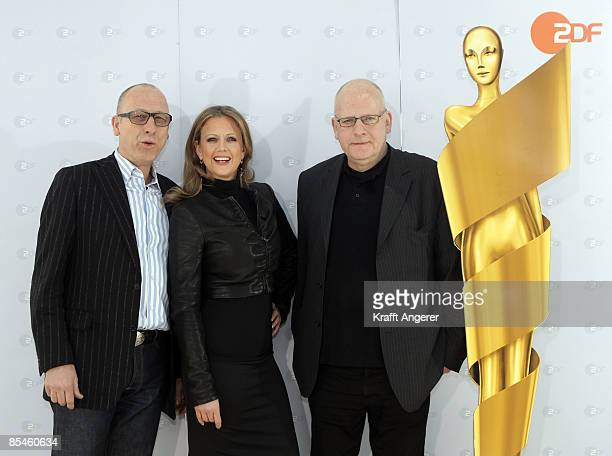 ZDF television entertainment head Manfred Teubner TV host Barbara Schoeneberger and artistic director HansChristoph Blumenberg pose during the photo...