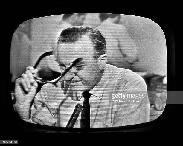 Television frame grab of American broadcast journalist and anchorman Walter Cronkite as he removes his glasses and prepares to announce the death of...