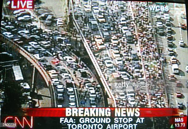 A television frame grab shows highways backed up due to an electricity blackout in NEw York City August 14 2003 in Washington DC Officials from the...