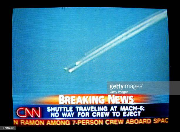 A television frame grab shows the breakup of the space shuttle Columbia minutes before a scheduled landing February 1 2003 as it crossed the United...