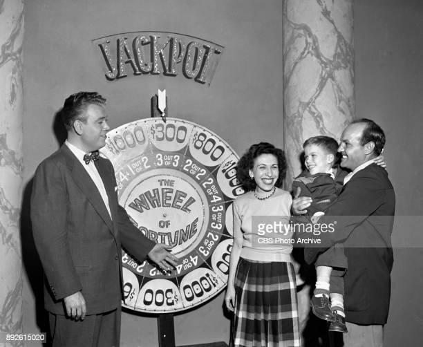 CBS television game show Wheel of Fortune Host Todd Russell with contestants New York NY October 17 1952
