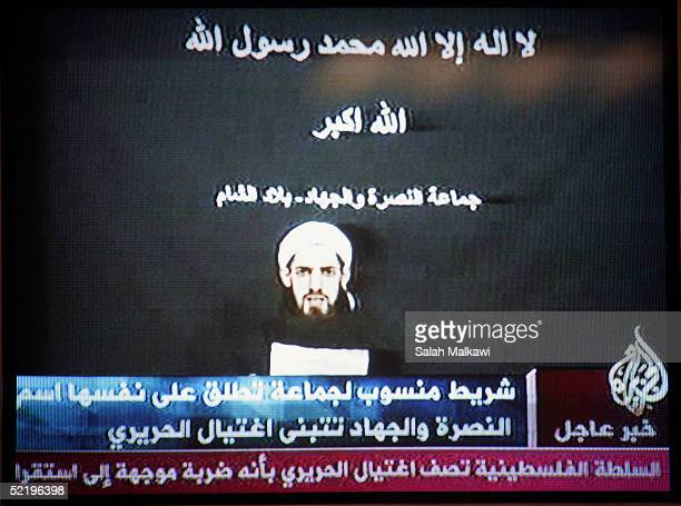 A television grab of Arabic News Channel AlJazeeera shows a still from a video tape claiming responsibility for the assassination of former Lebanese...