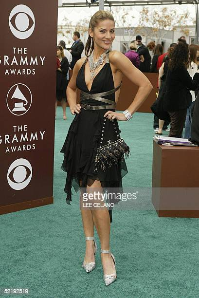 Television host Amanda Byram poses for photographers during the arrivals of the 47th Annual Grammy Awards in Los Angeles CA 13 February 2005 AFP...