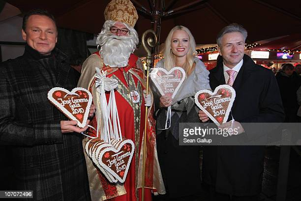 Television host Axel Bulthaupt Father Christmas model Franziska Knuppe and Berlin Mayor Klaus Wowereit attend the official opening of the Christmas...