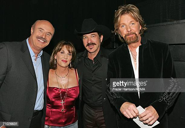 PRICING*** Television host Dr Phil McGraw wife Robin and Kix Brooks and Ronnie Dunn of Brooks Dunn pose backstage during the 41st Annual Academy Of...
