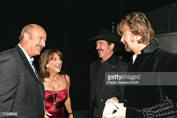 PRICING*** Television host Dr Phil McGraw wife Robin and Kix Brooks and Ronnie Dunn of Brooks Dunn talk backstage during the 41st Annual Academy Of...