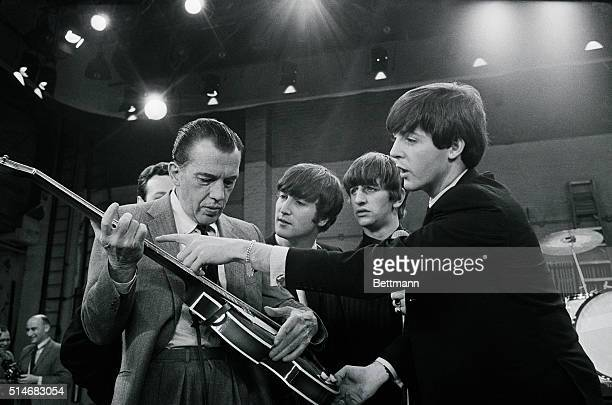 Television host Ed Sullivan receives some guitar lessons from Beatle Paul McCartney in between rehearsals at CBS television studios in Manhattan,...
