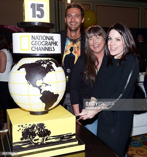 Television host Jason Silver television star Sue Aikens and Courteney Monroe CEO National Geographic Channel cuts the cake for National Geographic...