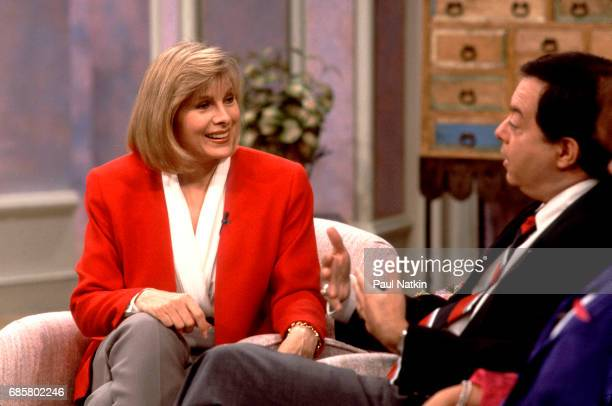 Television host Jenny Jones interviews an unidentified guest duing her talk show Chicago Illinois September 11 1991