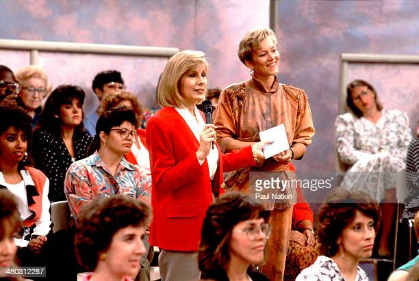 Television host Jenny Jones speaks with members of the audience during her talk show Chicago Illinois September 6 1991